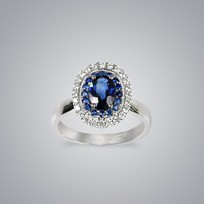 Diamond Surrounded Sapphire Ring